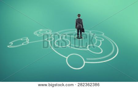 Businessman Stands In The Middle Of A Network Sketch Drawn On The Ground.