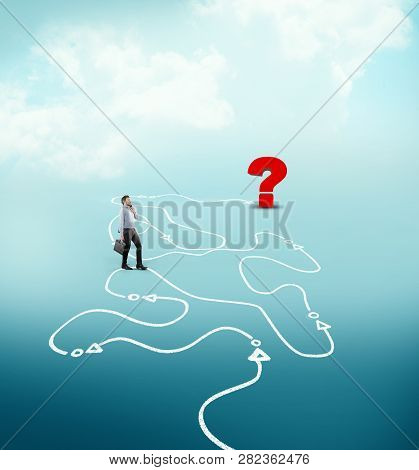 Businessman Following A Drawn Path To A Question Mark. The Concept Of Unknown