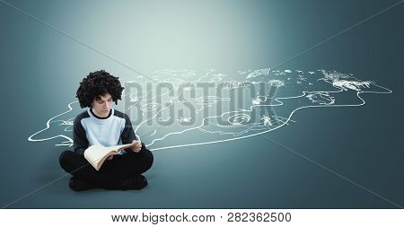 Teenager Reading A Book Next To A Drawn Suggesting Imagination Chaotic And Creative World - Image