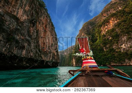 Wooden Boat At The Thai Islands. Old Wooden Boat On Asian Islands. Thai Phi Phi Islands. Boat In The