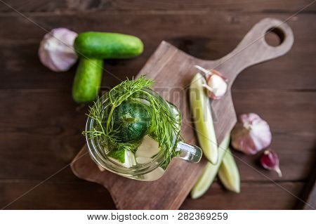 Fermented Food In A Can. Cucumbers, Dill, Garlic, Marinade. National Russian Food Pickles In Brine C