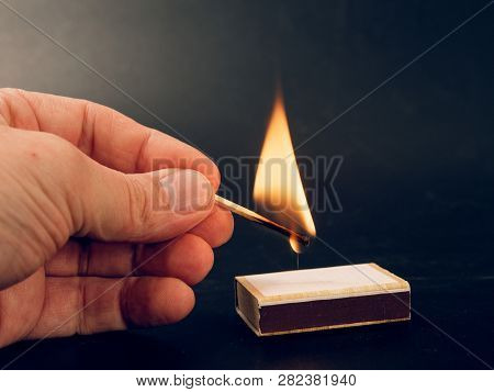 Match With A Fire Flame Burning Being Held By A Hand