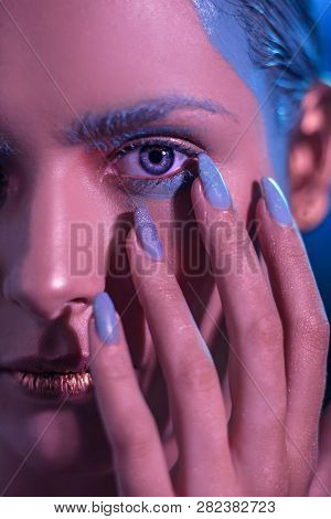 Young Stylish Girl With Bright Makeup With A Hand Near The Face. In The Neon Shade The Face Of The M