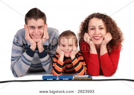 Parents With Son And Toy Railroad