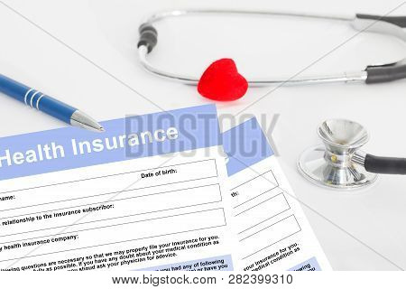 Health Insurance Form, Questionnaire With Stetoscope And Red Heart For Insurance Concept