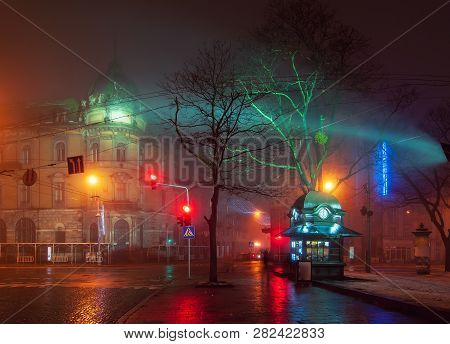 Beautiful Nightscape Of City Center Of Lviv, Ukraine At Foggy Night