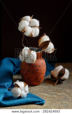 Cotton Branches And Vase On Stone Table