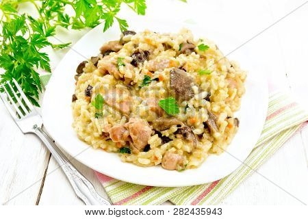 Risotto With Mushrooms And Chicken On Napkin