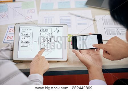 Contemporary Technical Developers Discussing Digital Schemes Of New Gadget Version In Touchpad And S