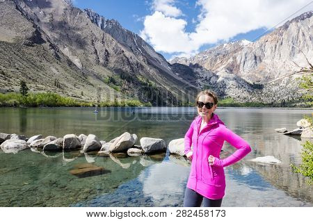 Female Adult Poses By Convict Lake In The Springtime, Located Off Of Us-395, Near Mammoth Lakes Cali