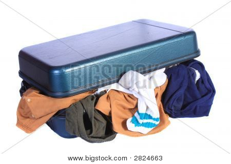 Open Luggage With Underwear Hanging Out