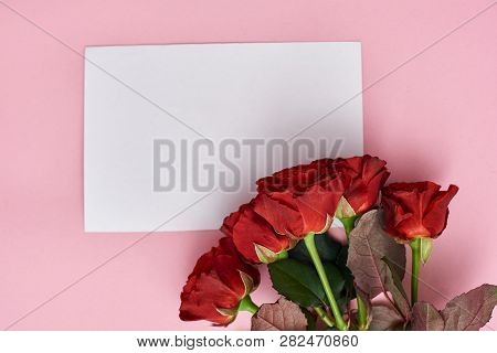 The Wish Of Love. Note Paper For Your Love Letter And Bouquet Of Fresh Roses.