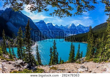 Canadian Rockies, Province of Alberta. Lake Moiraine with icy water of emerald color in Park Banff. The concept of ecological, photographic and active tourism