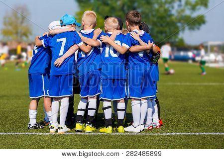 Kids Sport Team Gathering. Children Play Sports. Boys In Sports Jersey Uniforms Having Shout Team. C