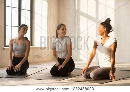 Smiling Multiracial Girls Talk Waiting For Fitness Training