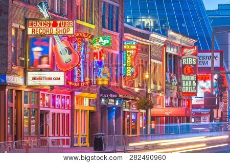 NASHVILLE, TENNESSEE - AUGUST 20, 2018: Honky-tonks on Lower Broadway. The district is famous for the numerous country music entertainment establishments.