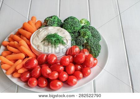 Homemade Buttermilk Ranch Salad Dressing With Dill Served With Fresh Vegetables, Cherry Tomatoes, Ba
