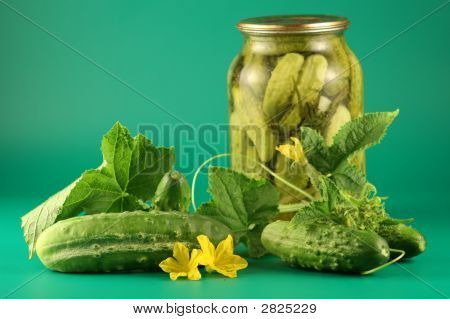 Still-Life With Pickles On A Green Background.