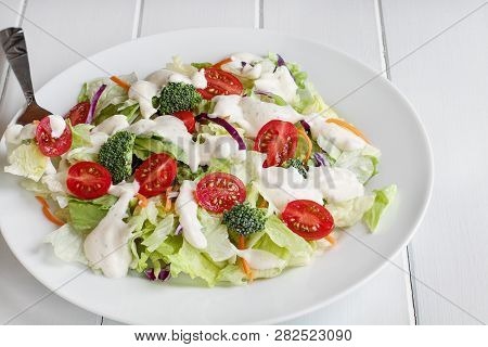 Plate Of Homemade Fresh Salad With Buttermilk Ranch Dressing, Tomatoes, Broccoli, Cabbage And Carrot