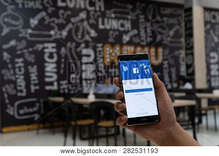 Chiang Mai, Thailand - Jan. 06,2019: Man Holding Huawei With Facebook App On The Screen. Facebook Is