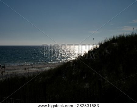 Sunshine As Seen On The Waters Of The Gulf Of Mexico From Behind A Sand Dune.