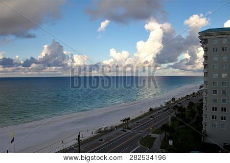 Clouds Line The Horizon Over The Calm, Clear Waters Of The Gulf Of Mexico, As Seen From A Condominiu