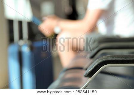 Passengers Waiting At The Airport/ Passenger Using Mobile Phone