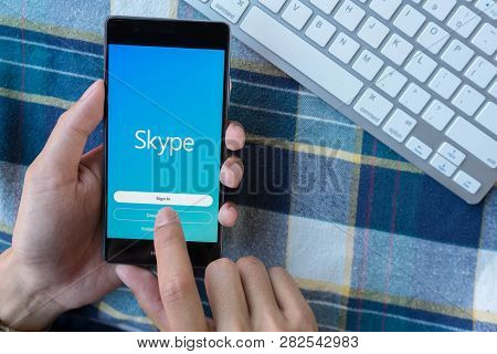 Chiang Mai, Thailand - Mar 28,2018: Man Holding Huawei With Skype  Login On Screen. Skype Is Part Of