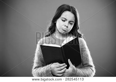 Girl Hold Book Read Story Over Orange Background. Child Enjoy Reading Book. Book Store Concept. Wond