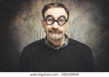 Funny portrait of a nerd man wearing nerd glasses