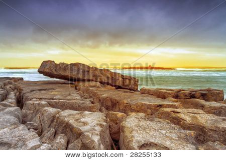 Sunset over Atlantic ocean with crab island view, Ireland