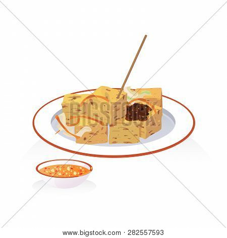 A Dish Of Deep Fried Stinky Tofu With Dipping Sauce And Pickled