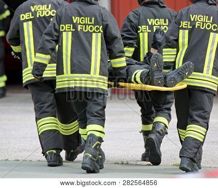 Vicenza, Vi, Italy - May 10, 2018: Italian Stretcher Bearers Firemen Transport An Injured On The Str