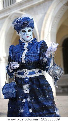 Venezia, Ve, Italy - February 5, 2018: Mask Of Blue Woman With Handbag At Saint Mark Square