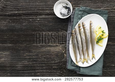 Seafood. Small Sea Small Fish Smelt, Anchovies, Sardines In The Form For Cooking With Oil, Salt And