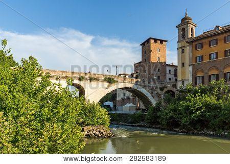 Rome, Italy - June 22, 2017: Cityscape With Castello Caetani, Tiber River And Pons Fabricius In City