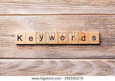 Keywords Word Written On Wood Block. Keywords Text On Wooden Table For Your Desing, Concept