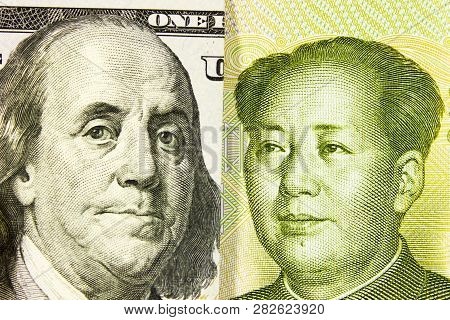 Portrait Of Franklin Against Mao Zedong, 100 Us Dollars And Chinese Yuan. Concept Of The Economic St