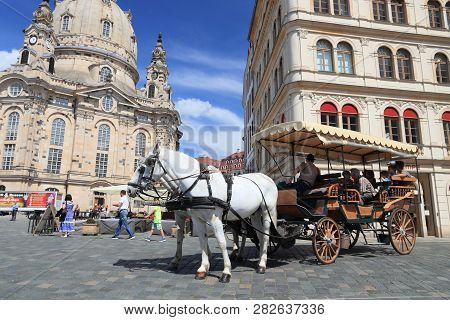 Dresden, Germany - May 10, 2018: Horse Carriage Ride At Neumarkt Square In Altstadt (old Town) Distr