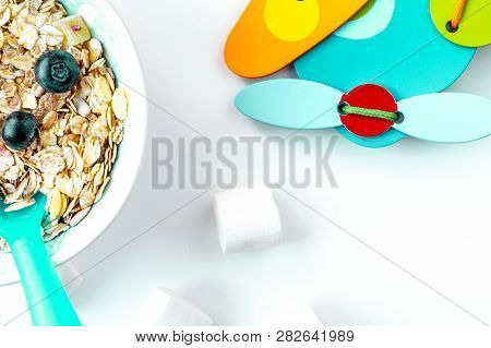 Concept Kid Breakfast With Muesli Top View On White Background