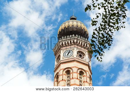 Clock Tower Of The Great Synagogue Of Budapest, Against Sky Background. Travel In Hungary. Summer Va