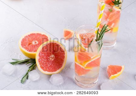 Grapefruit Lemonade. Two Glasses Of Refreshing Drink, Water With  Grapefruit, Rosemary Branches And