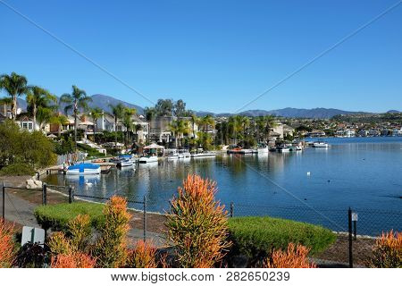 MISSION VIEJO, CA - JANUARY 23, 2018: Lake Mission Viejo. The lake is surrounded by private residential and condominium communities, some with boat docks.