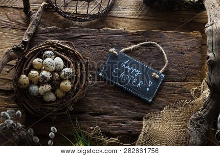 Easter Table Setting.quail Eggs In Nest. Spring Table. Happy Easter Text On Plate