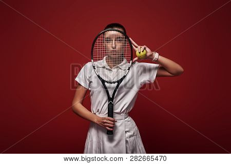 Refuse To Lose Young Tennis Player Standing Isolated Over Red Background With A Racket And A Ball