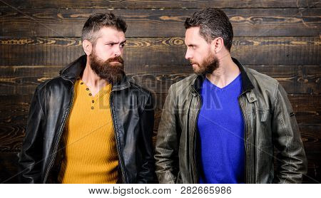 Exude masculinity. Men brutal bearded hipster. Confident competitors strict glance. Masculinity concept. Masculinity attributes. Brutality confidence and masculinity interconnection. True man temper poster