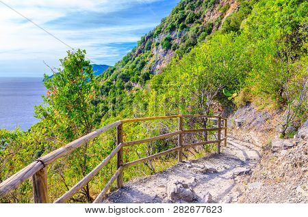 Pedestrian Hiking Stone Path Trail With Railing Between Corniglia And Vernazza Villages With Green T