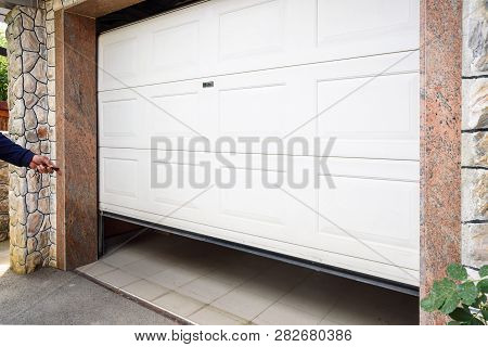 Garage Door Pvc. Hand Use Remote Controller For Closing And Opening Garage Door
