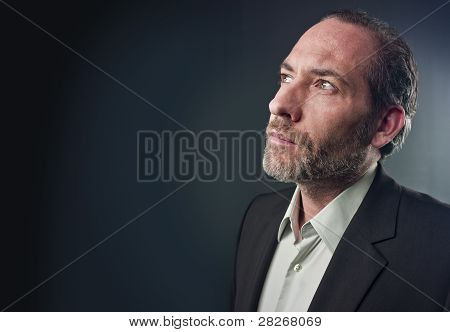Portrait Of A Thinking Businessman