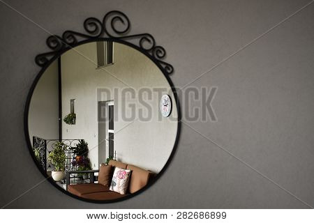 View of winter terrace through mirror, winter terrace furniture and decoration